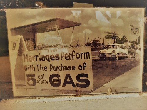 Marriage Ceremony with Gas Purchase Sign